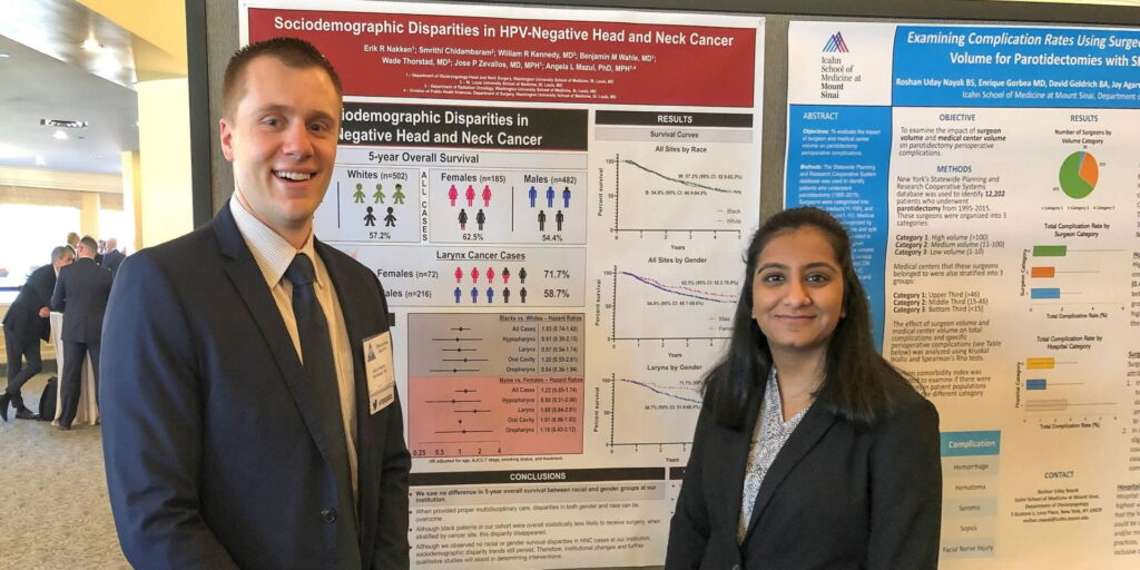Med students pose with Triologic poster