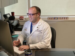 Dr. Bradley meets with a patient during a telehealth visit