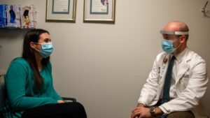 photo of audiologist and patient