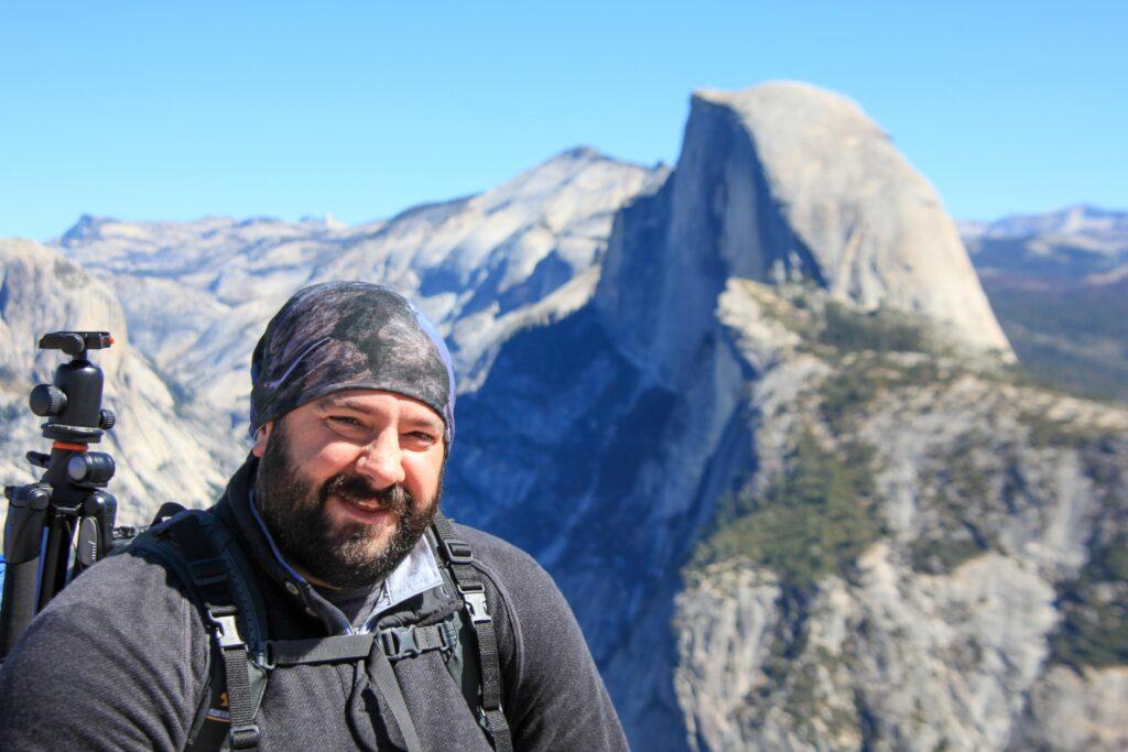 John Schneider in front of Yosemite's Half Dome